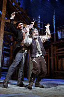 0382282 © Granger - Historical Picture ArchiveTHEATER PERFORMANCE.    'Fiddler On The Roof' - performance of the musical at the Savoy Theatre, London, UK, May 2007. Shown: Adrien Mastrosimone as The Fiddler and Henry Goodman as Tevye. Music by Jerry Bock. Lyrics by Sheldon Harnick. Book by Joseph Stein. Full credit: Tristram Kenton / Lebrecht Music & Arts / Granger, NYC -- All rights reserved.