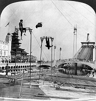 0105991 © Granger - Historical Picture ArchiveCONEY ISLAND: DREAMLAND.   Trapeze performers at Dreamland amusement park, Coney Island, Brooklyn, New York. Stereograph, c1904.