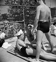 0267669 © Granger - Historical Picture ArchiveSWIMMING POOL, 1942.   Men at a municipal swimming pool in Washington, D.C.. Photograph by Marjory Collins, 1942.