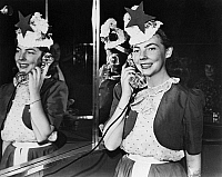 0259466 © Granger - Historical Picture ArchiveNEW YORK WORLD'S FAIR, 1939.   Melba Rae Toombs 'Miss Treasure Island' on phone at the American Telephone & Telegraph Exhibit at the New York World's Fair in Flushing Meadows, Queens, New York. Photograph, 1939.