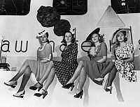 0260013 © Granger - Historical Picture ArchiveNEW YORK WORLD'S FAIR, 1939.   Women modeling the first nylon stockings at the at the New York World's Fair in Flushing Meadows, Queens, New York. Photograph, 1939.