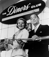 0621573 © Granger - Historical Picture ArchiveNEW YORK WORLD'S FAIR, 1964.   Patti Page cutting the ribbon at the opening of the Diners Club exhibit, alongside Ralph Schneider. Photograph, 1964.