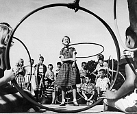 0169648 © Granger - Historical Picture ArchiveHULA HOOP, 1950s.   A 10-year-old girl shows off her hula hoop skills to her classmates, 1950s.