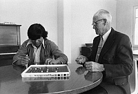 0172724 © Granger - Historical Picture ArchiveMISSISSIPPI: BOARD GAME, 1973.   A Native American boy playing the board game 'Aggravation' with foster grandparent George Jones, age 75, at the East Mississippi State Hospital in Meridian, Mississippi. Photographed by Paul Conklin, 1973.