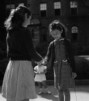 0323833 © Granger - Historical Picture ArchiveHOPSCOTCH, 1942.   A Chinese-American girl playing hopscotch with her Jewish friend outside her home in Flatbush, Brooklyn, New York. Photograph by Marjory Collins, 1942.