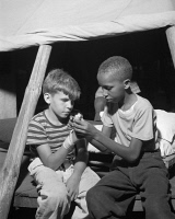 0351609 © Granger - Historical Picture ArchiveSUMMER CAMP, 1943.   Campers practicing first aid at Camp Nathan Hale, an interracial summer camp in Southfields, New York. Photograph by Gordon Parks, 1943.