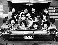0129420 © Granger - Historical Picture ArchiveCOLLEGIATE FUN, 1960.   Twelve female students in Windsor, Ontario, Canada, packed into the trunk of a car, 1960.