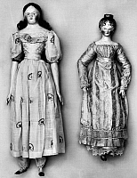 0125939 © Granger - Historical Picture ArchiveDOLLS, 1790s.   Dolls with (left) wax head, wooden hands and feet, and embroidered muslin dress with full skirt and puffy sleeves; and (right) painted wooden head, hands and feet, and long sleeved dress. American, 1790s.