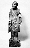 0122468 © Granger - Historical Picture ArchiveCHINA: LOHAN.   A lohan holding prayer beads in one hand, with the other raised in a preaching gesture. Marble. Height: 42 in. Jin Dynasty, northern China, 1180.
