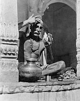 0124530 © Granger - Historical Picture ArchiveINDIA: BRAHMIN PRIEST.   A Brahmin priest painting his forehead with the red and white marks of his sect and caste. Photograph, early 20th century.