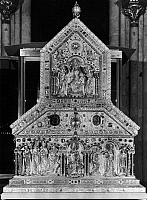 0167476 © Granger - Historical Picture ArchiveCOLOGNE: MAGI SHRINE.   Front end of the Shrine of the Three Kings in the cathedral of Cologne, Germany, with relief figures representing Christ in majesty (top), the adoration of the Magi (lower left), and the baptism of Christ (lower right). Wood with gold and silver overlay, decorated with filigree, enamel, and jewels, late 12th-early 13th century.