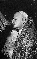 0011941 © Granger - Historical Picture ArchiveJOHN XXIII (1881-1963).   Pope, 1958-1963. Kissing the foot of the statue of St. Peter on 28 June 1960, the eve of the feast day of the apostle, when the statue is robed in rich vestements.