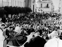0170199 © Granger - Historical Picture ArchiveJOHN XXIII (1881-1963).   Pope, 1958-1963. Pope John (left foreground) blessing the crowd in Castel Gandolfo, Italy, following a mass in observance of the Feast of the Assumption, 15 August 1962.