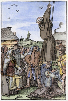 0071471 © Granger - Historical Picture ArchivePEASANT MOB, 1525.   Peasants in Switzerland hanging a vendor of indulgences during the Reformation. Woodcut, 1525, by Niklaus Manuel Deutsch.