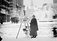 0106740 © Granger - Historical Picture ArchiveSALVATION ARMY, c1910.   Salvation Army volunteer collecting funds for Christmas dinner from the Salvation Army, New York City.