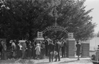 0408582 © Granger - Historical Picture ArchiveLOUISIANA: CONGREGATION.   A church congregation observing All Saints' Day outside of the cemetery in New Roads, Louisiana. Photograph by Russell Lee, 1938.