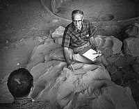 0186690 © Granger - Historical Picture ArchiveGEORGE S. CATTANACH   (1926-2011). American archaeologist, at the Step House Wetherill Mesa, at Mesa Verde National Park in Colorado. Photograph by Fred Mang, Jr., for the National Park Service, c1980.
