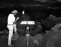 0186692 © Granger - Historical Picture ArchiveWETHERILL MESA, c1980.   Surveyors mapping site 1291 of Wetherill Mesa at Mesa Verde National Park in Colorado. The site is believed to have been occupied from the Basketmaker III Era of about 600 A.D. through Pueblo III Era of about 1350 A.D. Photograph by Fred Mang, Jr. for the National Park Service, c1980.