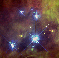 0186274 © Granger - Historical Picture ArchiveSPACE: TRAPEZIUM CLUSTER.   A view of the four massive stars of the Trapezium Cluster, with a number of evaporating protoplanetary disks, in the center of the Orion Nebula (M42) in the constellation Orion, about 1,500 light years from Earth. False-color mosaic of photographs taken by NASA's Hubble Space Telescope, 1997.
