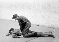 0322630 © Granger - Historical Picture ArchiveBOY SCOUTS, 1912.   Two Boy Scouts demonstrating first aid techniques. Photograph, 1912.