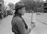 0322680 © Granger - Historical Picture ArchiveMAINE: BOY SCOUT, 1940.   A Boy Scout holding string at the finish line of a barrel rolling contest in Presque Isle, Maine