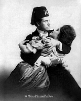 0108232 © Granger - Historical Picture ArchiveFREEMASON, 1908.   'A Mason Holding His Own.' A Freemason embracing a woman passionately, 1908.