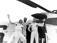 0184184 © Granger - Historical Picture ArchiveAPOLLO 8, 1968.   Astronauts Frank Borman, James Lovell Jr. and William Anders waving from the door of a helicopter after their Apollo 8 mission. Photograph, December 1968.