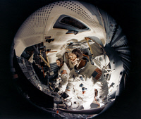 0184311 © Granger - Historical Picture ArchiveAPOLLO 9, 1969.   Fish-eye view of astronauts James McDivitt and Russell Schweickart inside the Apollo 9 Lunar Module Mission Simulator at Kennedy Space Center, Florida. Photograph, 1969.