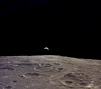 0184603 © Granger - Historical Picture ArchiveAPOLLO 12: EARTH, 1969.   A view of the earth rising over the moon's horizon. Photographed from the Apollo 12 spacecraft, 1969.