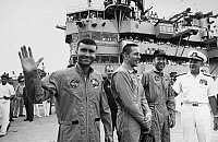 0184971 © Granger - Historical Picture ArchiveAPOLLO 13: RESCUE, 1970.   Astronauts Fred Haise, John Swigert, and James Lovell, the crew of the Apollo 13, with Rear Admiral Donald Davis aboard the USS Iwo Jima following splashdown in the South Pacific. Photograph, 1970.