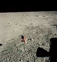 0185137 © Granger - Historical Picture ArchiveAPOLLO 11: FLAG, 1969.   American flag planted on the surface of the moon by astronauts Neil Armstrong and Edwin 'Buzz' Aldrin (whose footprints are also visible), photographed from inside the Apollo 11 lunar module, 20 July 1969.