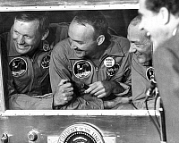0268226 © Granger - Historical Picture ArchiveSPACE: APOLLO 11, 1969.   Astronauts Neil Armstrong, Michael Collins, and Edwin 'Buzz' Aldrin in the quarantine, laughing with President Richard Nixon, following the Apollo 11 mission. Photograph, 1969.
