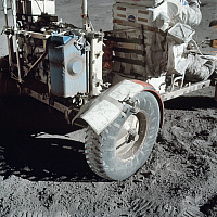 0269078 © Granger - Historical Picture ArchiveAPOLLO 17: REPAIRS, 1972.   Repairs made to the rear fender of the lunar roving vehicle using spare maps, clamps and tape, during the Apollo 17 mission. Photograph, December 1972.