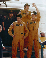 0322383 © Granger - Historical Picture ArchiveAPOLLO 17: CREW, 1972.   Astronauts Eugene Cernan, Ron Evans, and Jack Schmitt exiting the recovery helicopter on-board the U.S.S. Ticonderoga, following the completion of the Apollo 17 mission. Photograph, 19 December 1972.