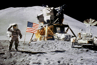 0029323 © Granger - Historical Picture ArchiveAPOLLO 15: JIM IRWIN, 1971.   Astronaut Jim Irwin saluting the American flag by the lunar rover and the lunar module 'Falcon' at the Hadley-Apennine landing site, during the Apollo 15 mission, 1 August 1971. Hadley Delta is visible in the background. Photographed by Astronaut David R. Scott.