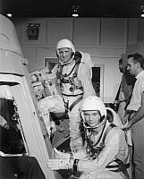 0184078 © Granger - Historical Picture ArchiveSPACE: ASTRONAUTS, 1965.   NASA astronauts Edward Higgins White and Michael Collins preparing for flight simulation. Photograph, 1965.