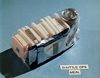 0184107 © Granger - Historical Picture ArchiveSPACE: FOOD PACKAGE, 1982.   A view of a meal package for use by astronauts during space shuttle missions. Photograph, 1982.
