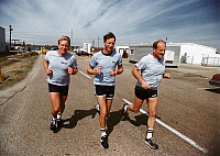 0184175 © Granger - Historical Picture ArchiveSPACE: TRAINING, 1988.   NASA astronauts on a jog during training. Left to right: George Nelson, Richard Covey and Frederick Hauck. Photograph by Keith Meyers, 1988.