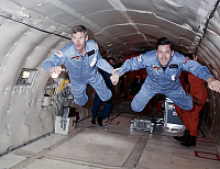 0184177 © Granger - Historical Picture ArchiveSPACE: TRAINING, 1986.   British astronauts Nigel Wood and Richard Farrimond floating in microgravity during training. Photograph, 1986.