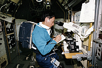 0184319 © Granger - Historical Picture ArchiveMAMORU MOHRI (1948- ).   Japanese scientist and astronaut. Photographed participating in an experiment onboard the Space Shuttle Endeavour during the STS-47 mission, 1993.