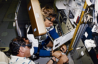 0184322 © Granger - Historical Picture ArchiveSPACE: ASTRONAUTS, 1993.   Astronauts Curtis Brown and Mark C. Lee performing maintenance onboard the Space Shuttle Endeavour during the STS-47 mission, 1993.