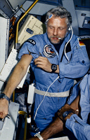 0184326 © Granger - Historical Picture ArchiveREINHARD FURRER (1940-1995).   German physicist and astronaut. Photographed after having blood drawn onboard the Space Shuttle Challenger during the STS-61A mission, 1985.