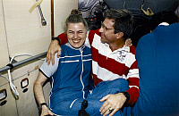 0184995 © Granger - Historical Picture ArchiveSPACE: ASTRONAUTS, 1996.   American astronauts Shannon Lucid and John Blaha aboard the Space Shuttle Atlantis shortly after docking to the Space Station Mir. Photograph, 1996.