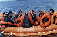 0185369 © Granger - Historical Picture ArchiveSPACE: ASTRONAUTS, 1980.   American and European astronauts in a raft during water survival training at the Homestead Air Force Base in Florida. Photograph, 1980.