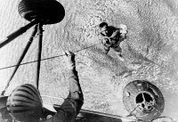 0621698 © Granger - Historical Picture ArchiveALAN SHEPARD (1923-1998).   American astronaut. Shepard being hauled into a helicopter after landing the first ever manned Mercury space capsule (lower right) in the water near the USS Champlain. Photograph, 1961.