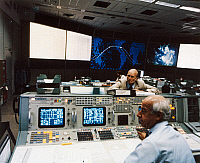 0185533 © Granger - Historical Picture ArchiveSPACE: MISSION CONTROL, 1983.   Astronaut C. Gordon Fullerton (standing) advises Edward Fendell at the intergrated communications system console at the mission control center at Johnson Space Center in Houston, Texas, during communication with the Space Shuttle Challenger during the STS-7 Mission, June 1983.