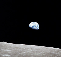 0184420 © Granger - Historical Picture ArchiveAPOLLO 8: EARTH, 1968.   A view of Earth rising over the Moon's horizon, taken from the Apollo 8 spacecraft. Photograph, 1969.