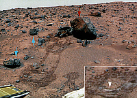 0185364 © Granger - Historical Picture ArchiveMARS: ROCKS, 1997.   Three types of rocks on Mars: Yogi, large, rounded, and weathered (red arrow); Barnacle Bill and Cradle, smaller, angular, and unweathered (blue arrows); and white flat rocks (inset, white arrow). False-color version of a photograph taken by the Imager for Mars Pathfinder (IMP), July 1997.