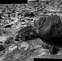 0186403 © Granger - Historical Picture ArchiveMARS: SOJOURNER, 1997.   The Sojourner rover approaching the rock Yogi while exploring the surface of Mars during the Mars Pathfinder mission, July 1997. Its front wheels are raised off the ground as a result of friction on the rear wheels.