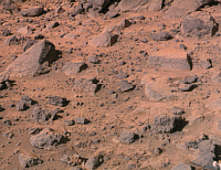 0186415 © Granger - Historical Picture ArchiveMARS: ROCKS, 1997.   A stretch of rocky terrain on the surface of Mars, photographed by the Imager for Mars Pathfinder (IMP), July 1997. The most prominent rocks shown are Wedge (pointed, left) and Flat Top (rectangular, right).